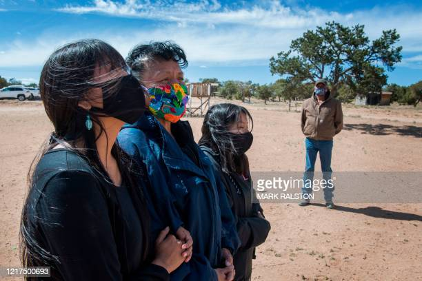 Emerson Gorman who is a Navajo elder poses at his property with his daughter Naiyahnikai wife Beverly and grandchild Nizhoni near the Navajo Nation...