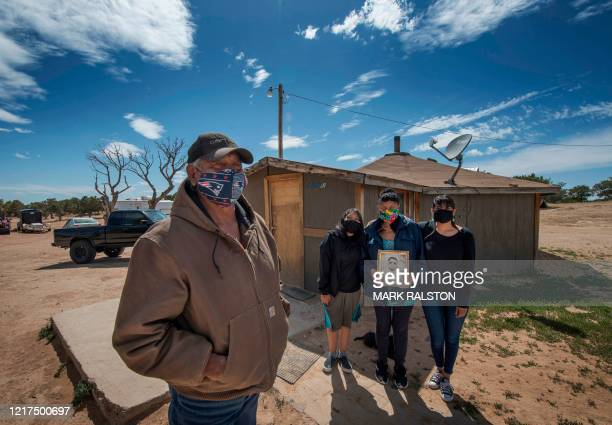Emerson Gorman who is a Navajo elder poses at his property with his grandchild Nizhoni wife Beverly and daughter Naiyahnikai near the Navajo Nation...