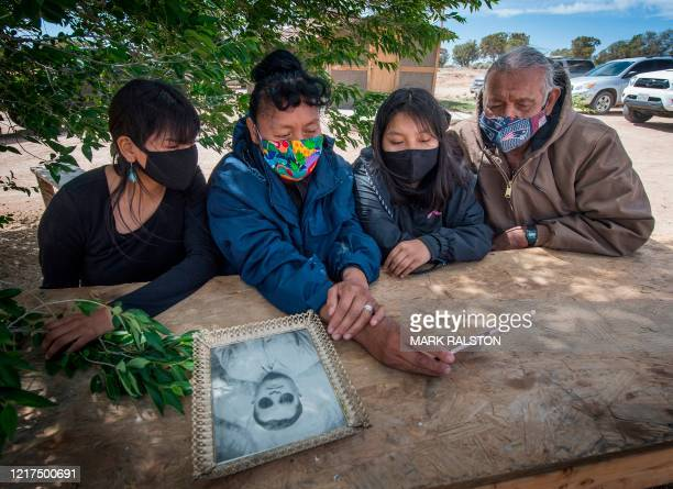 Emerson Gorman who is a Navajo elder sits with his daughter Naiyahnikai wife Beverly and grandchild Nizhoni near the Navajo Nation town of Steamboat...