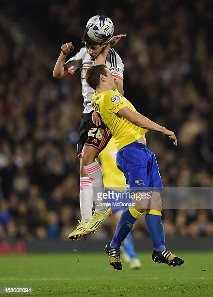 Emerson Hyndman of Fulham battles with Craig Bryson of Derby County during the Capital One Cup fourth round match between Fulham Derby County at...