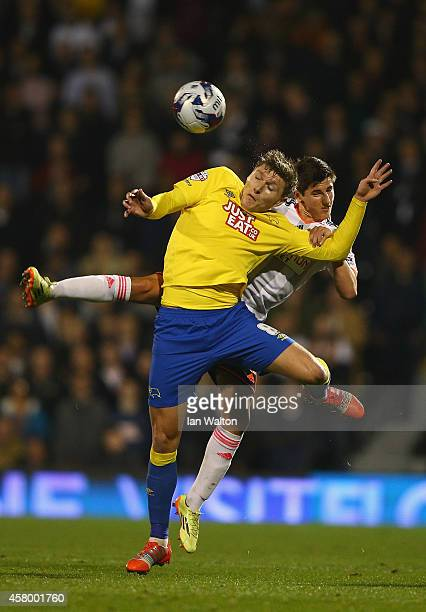 Emerson Hyndman of Fulham tries to tackle Jeff Hendrick of Derby County during the Capital One Cup Fourth Round match between Fulham and Derby County...