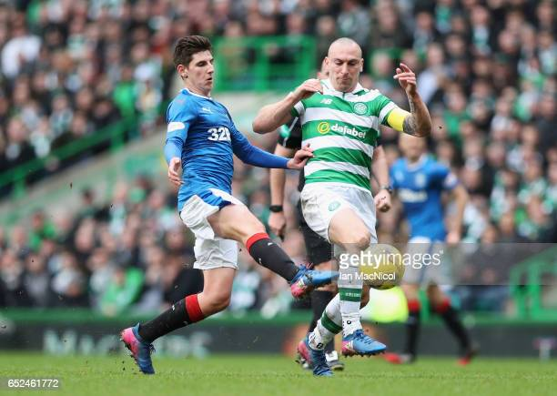Emerson Hyndman of Rangers and Scott Brown of Celtic battle for possession during the Ladbrokes Scottish Premiership match between Celtic and Rangers...