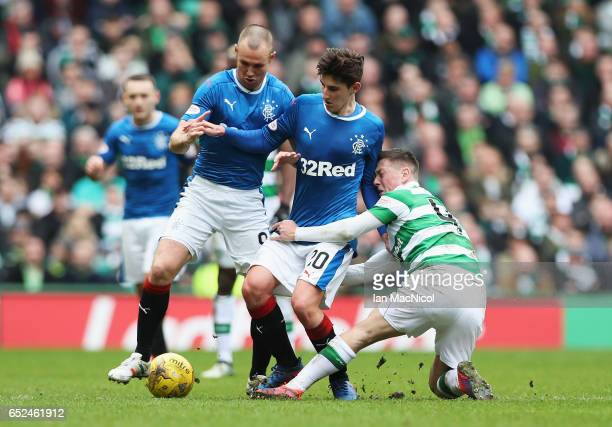 Emerson Hyndman of Rangers is tackled by Callum McGregor of Celtic during the Ladbrokes Scottish Premiership match between Celtic and Rangers at...