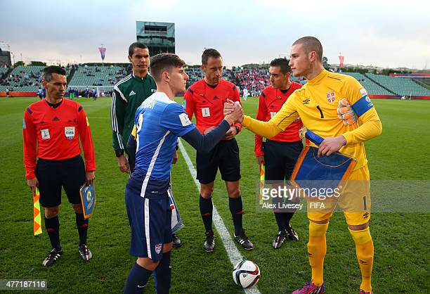 Emerson Hyndman the captain of USA and Predrag Rajkovic the captain of Serbia shake hands prior to the FIFA U20 World Cup Quarter Final match between...