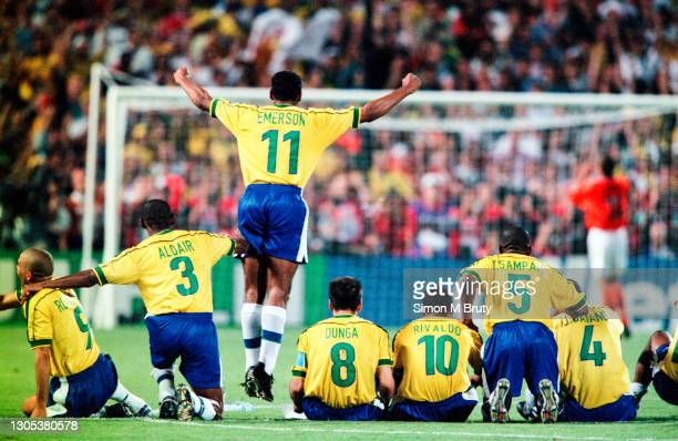 Emerson jumps up as he and the rest of the Brazil team watch as Philip Cocu of Holland misses the second penalty for the Dutch team.The Semi Final of...