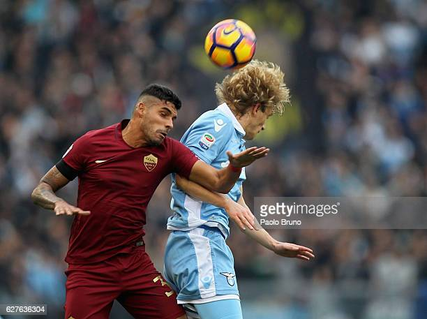 Emerson of AS Roma competes for the ball with Dusan Basta of SS Lazio during the Serie A match between SS Lazio and AS Roma at Stadio Olimpico on...