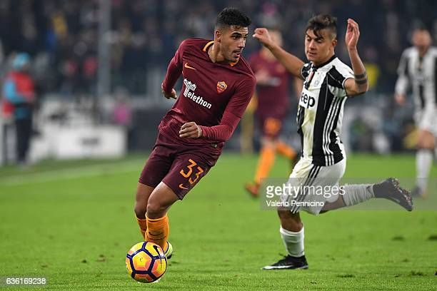 Emerson of AS Roma in action against Paulo Dybala of Juventus FC during the Serie A match between Juventus FC and AS Roma at Juventus Stadium on...