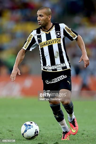 Emerson of Botafago advances the ball against Gremio during a match between Botafogo and Gremio as part of Brasileirao Series A 2014 at Maracana...