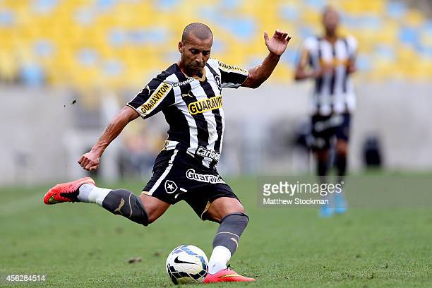 Emerson of Botafago takes a shot on goal against Gremio during a match between Botafogo and Gremio as part of Brasileirao Series A 2014 at Maracana...