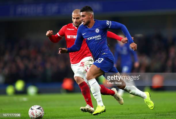Emerson of Chelsea runs with the ball past Adlene Guedioura of Nottingham Forest during the FA Cup Third Round match between Chelsea and Nottingham...