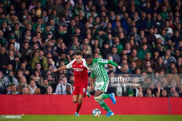 Emerson of Real Betis competes for the ball with Sergio Reguilon Rodriguez of Sevilla FC during the Liga match between Real Betis Balompie and...