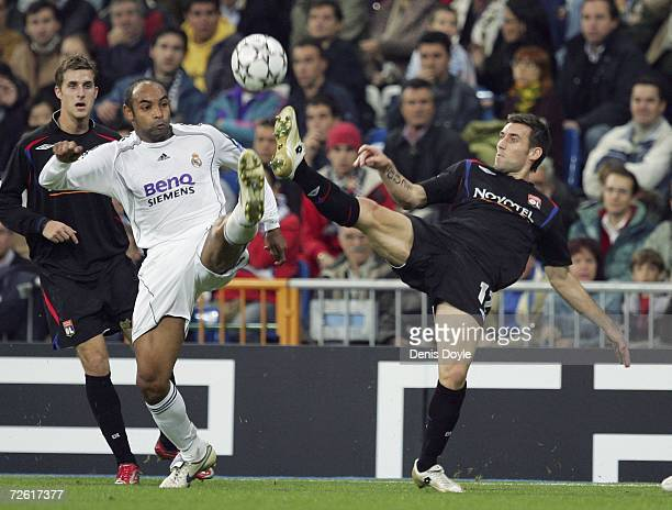 Emerson of Real Madrid and Anthony Reveillere of Lyon challenge for the ball during the UEFA Champions League Group E match between Real Madrid and...