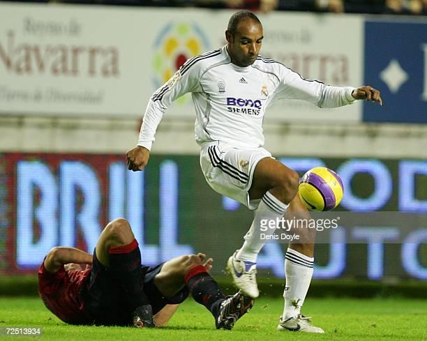 Emerson of Real Madrid beats an Osasuna player during the Primera Liga match between Osasuna and Real Madrid at the Reyno de Navarra stadium on...