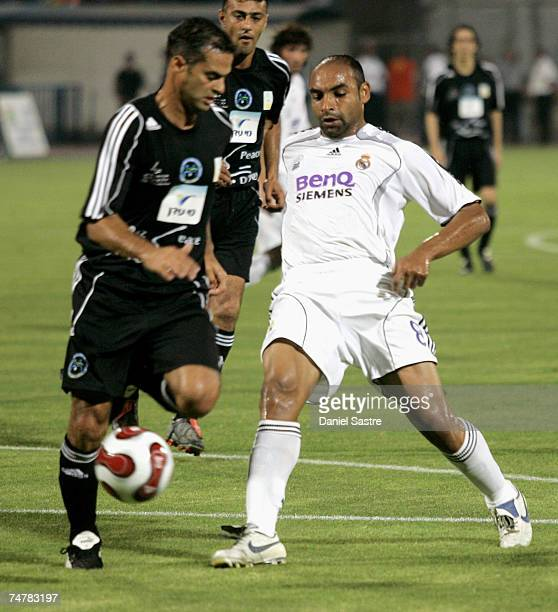 Emerson of Real Madrid competes for the ball with a member of the Peace team during a friendly match between Real Madrid and a Palestinian & Israeli...