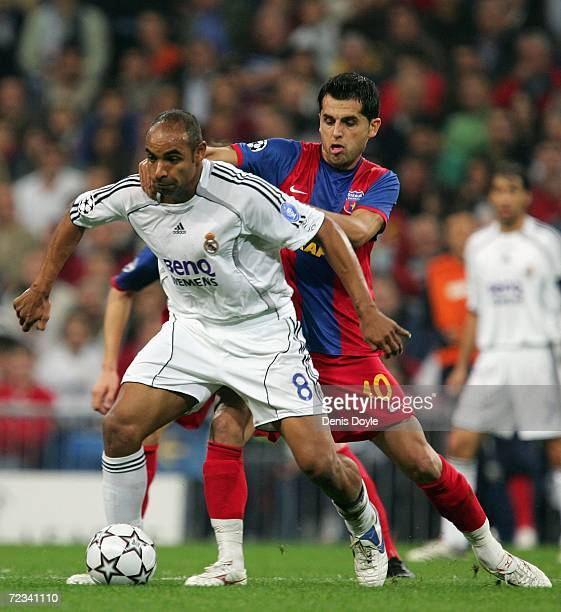 Emerson of Real Madrid fends off Nicolae Dica of Steaua Bucharest during the UEFA Champions League Group E match between Real Madrid and Steaua...