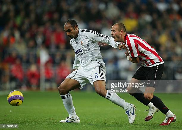 Emerson of Real Madrid fends Yeste of Athletic Bilbao during their Primera Liga match at the Santiago Bernabeu stadium on December 3, 2006 in Madrid,...