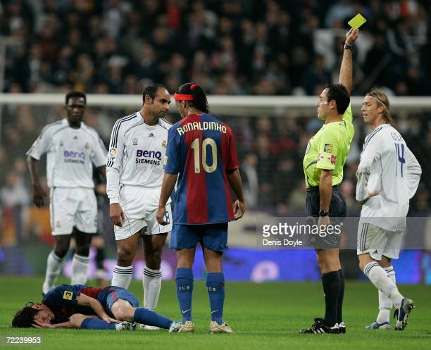 Emerson of Real Madrid gets a yellow card from referee Alfonso Perez Burrull during the Primera Liga match between Real Madrid and Barcelona at the...