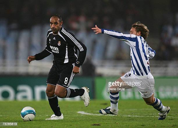 Emerson of Real Madrid gets past Diego Rivas of Real Sociedad during the La Liga match between Real Sociedad and Real Madrid at the Anoeta stadium on...