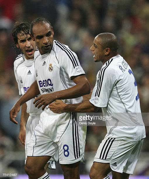Emerson of Real Madrid is congratulated by Roberto Carlos and Rauil Gonzalez after scoring Real's first goal during the Primera Liga match between...