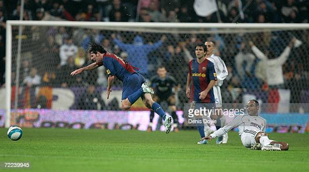 Emerson of Real Madrid is tackled by Lionel Messi of Barcelona during the Primera Liga match between Real Madrid and Barcelona at the Santiago...