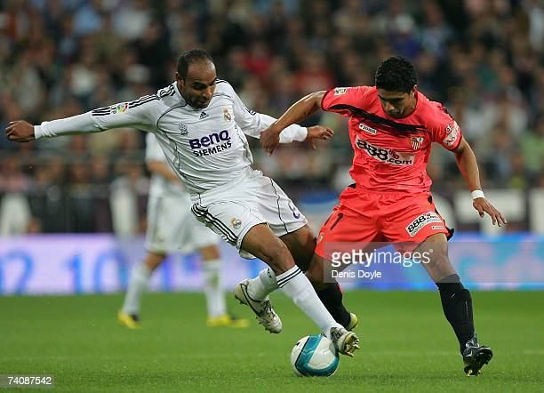 Emerson of Real Madrid is tackled by Renato Dirnei of Sevilla during the Primera Liga match between Real Madrid and Sevilla on May 6, 2007 in Madrid,...