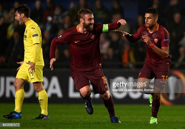 Emerson of Roma celebrates scoring his team's first goal with his teammate Daniele De Rossi during the UEFA Europa League Round of 32 first leg match...
