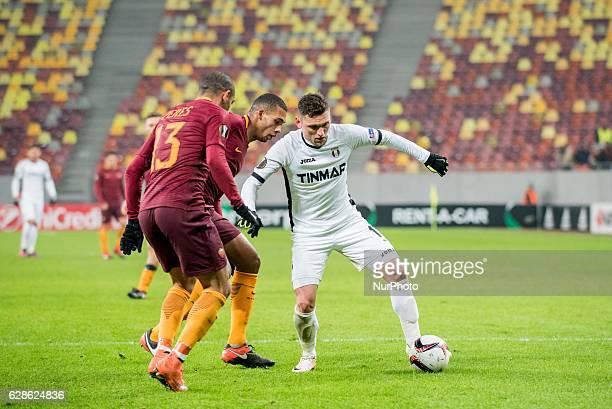 Emerson Palmieri of AS Roma and Alexandru Stan of FC Astra Giurgiu during the UEFA Europa League 20162017 Group E game between FC Astra Giurgiu and...