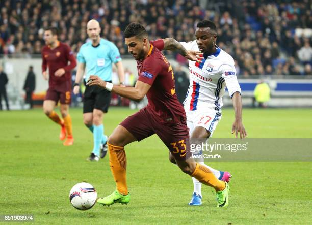 Emerson Palmieri of AS Roma and Maxwell Cornet of Lyon in action during the UEFA Europa League Round of 16 first leg match between Olympique Lyonnais...