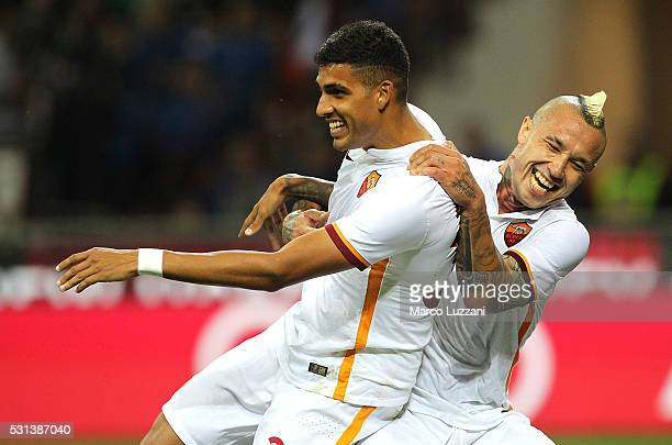 Emerson Palmieri of AS Roma celebrates his goal with his teammate Radja Nainggolan during the Serie A match between AC Milan and AS Roma at Stadio...