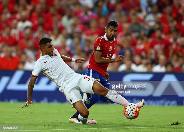 Emerson Palmieri of AS Roma compete for the ball with Moamen Zakaria Abbas of Al Ahli during the friendly match between AS Roma and Al Ahly on May 20...