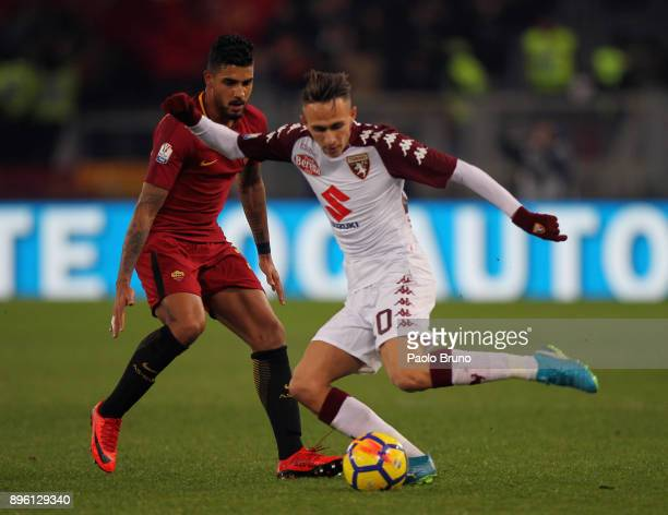 Emerson Palmieri of AS Roma competes for the ball with Simone Edera of Torino FC during the TIM Cup match between AS Roma and Torino FC at Olimpico...