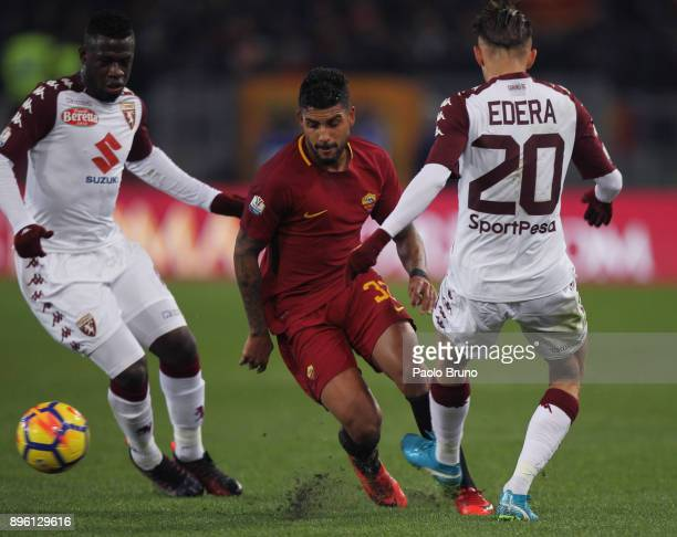 Emerson Palmieri of AS Roma competes for the ball with Simone Edera and Ebenezer Acquah of Torino FC during the TIM Cup match between AS Roma and...