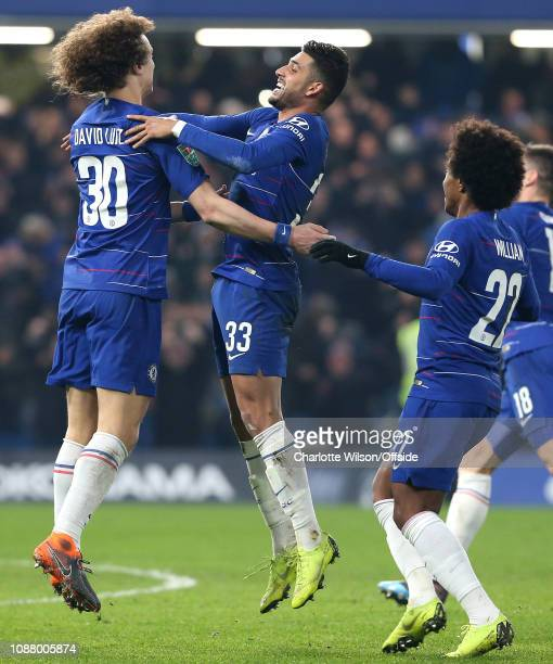 Emerson Palmieri of Chelsea celebrates with David Luiz of Chelsea who scored the winning penalty during the Carabao Cup SemiFinal Second Leg match...