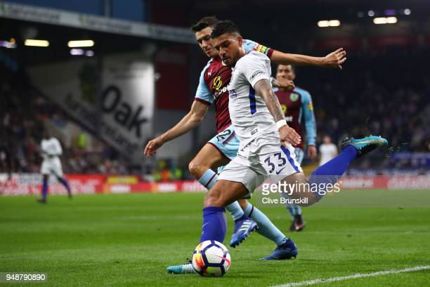 Emerson Palmieri of Chelsea crosses the ball under pressure from Matthew Lowton of Burnley during the Premier League match between Burnley and...