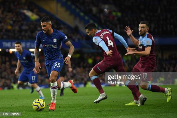 Emerson Palmieri of Chelsea gerts wawy from Fabian Balbuena and Robert Snodgrass of West Ham Unitedduring the Premier League match between Chelsea FC...