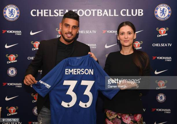 Emerson Palmieri of Chelsea holds his new shirt alongside Director of Chelsea Marina Granovskaia at Stamford Bridge on January 30 2018 in London...