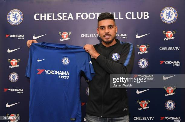 Emerson Palmieri of Chelsea holds his new shirt at Stamford Bridge on January 30 2018 in London England