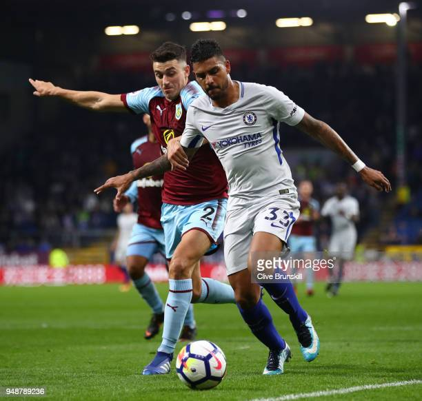 Emerson Palmieri of Chelsea is challenged by Matthew Lowton of Burnley during the Premier League match between Burnley and Chelsea at Turf Moor on...