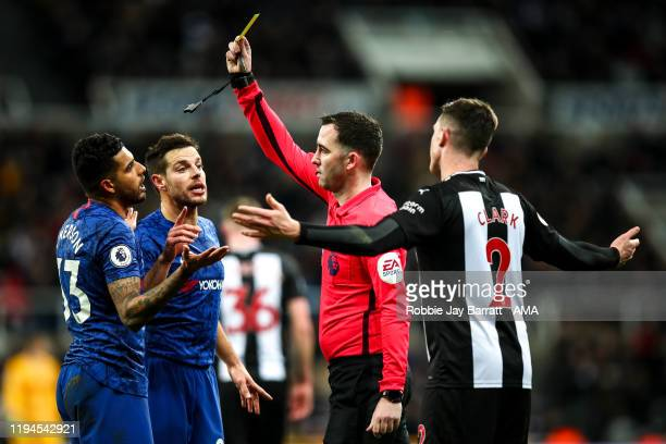 Emerson Palmieri of Chelsea receives a yellow card from Referee Chris Kavanagh for diving during the Premier League match between Newcastle United...