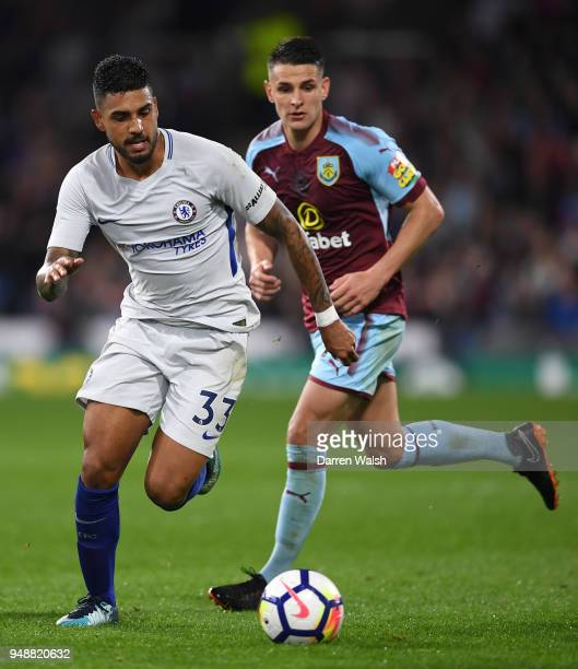 Emerson Palmieri of Chelsea runs with the ball under pressure from Ashley Westwood of Burnley during the Premier League match between Burnley and...