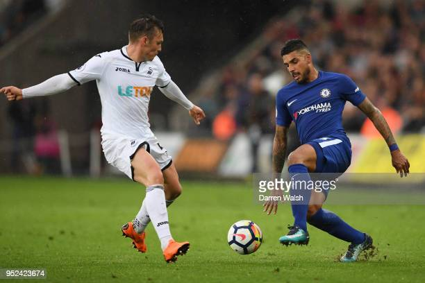 Emerson Palmieri of Chelsea runs with the ball under pressure from Connor Roberts of Swansea City during the Premier League match between Swansea...