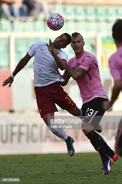 Emerson Palmieri of Roma and Aljaz Struna of Palermo compete for the ball during the Serie A match between US Citta di Palermo and AS Roma at Stadio...