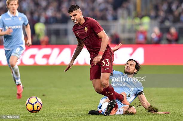 Emerson Palmieri of Roma is challenged by Marco Parolo of Lazio during the Serie A match between Lazio v Roma on December 4 2016 in Rome Italy