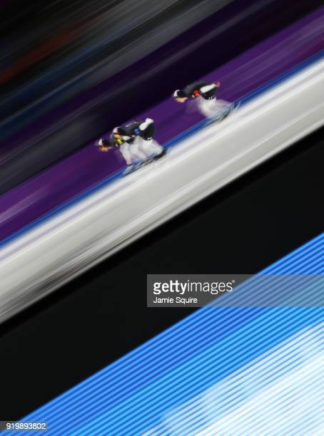 Emery Lehman Joey Mantia and Brian Hansen of the United States compete during the Men's Team Pursuit Speed Skating Quarter Finals on day nine of the...