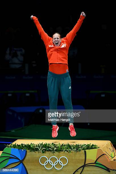 Emese Szasz of Hungary celebrates on the podium after winning the Women's Epee Individual Gold Medal on Day 1 of the Rio 2016 Olympic Games at...