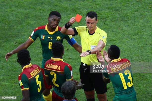 Emest Mabouka of Cameroon is shown a red card by referee Wilmar Roldan after advice from the VAR during the FIFA Confederations Cup Russia 2017 Group...