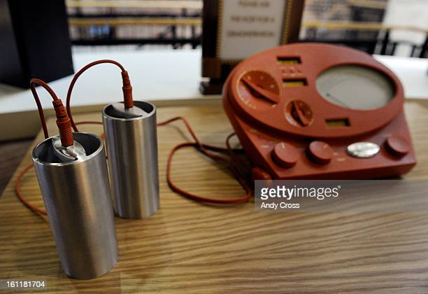 'Emeters' metal cylinders held in each hand help to register thoughts during audits and counseling at the new Church of Scientology of Denver at...