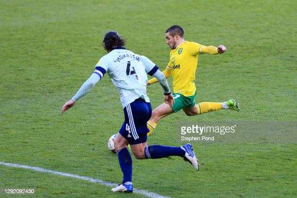 Emi Buendía of Norwich City scores their sides first goal during the Sky Bet Championship match between Norwich City and Cardiff City at Carrow Road...