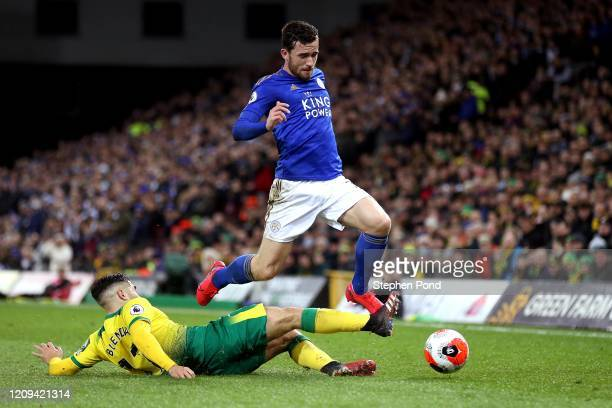 Emi Buendia of Norwich City and Ben Chillwell of Leicester City compete for the ball during the Premier League match between Norwich City and...