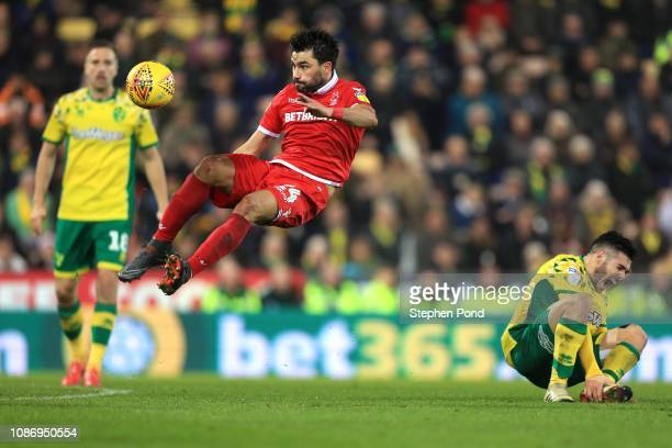 Emi Buendia of Norwich City and Claudio Yacob of Nottingham Forest compete for the ball during the Sky Bet Championship match between Norwich City...